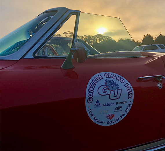 A vintage car with a Gonzaga Bay Area alumni decal on the side.