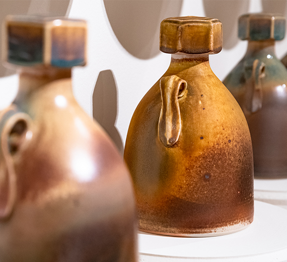 Three growlers with screw top lids, cast porcelain by Mat Rude