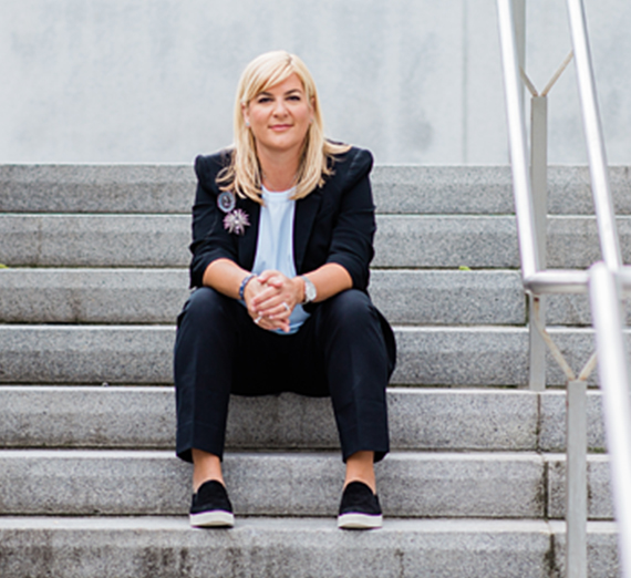 business woman sitting on steps