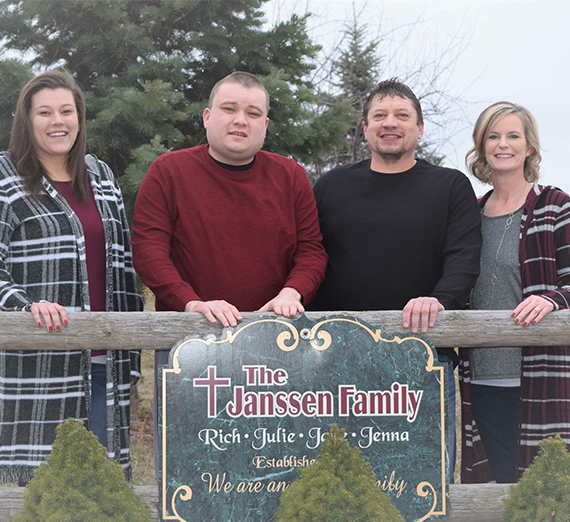 The Janssen Family stands outside their new adult group home.