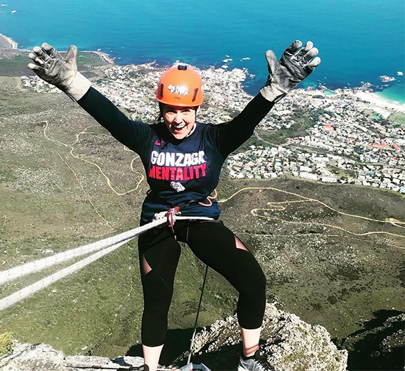 alum marissa clark hangs off high ledge in south africa