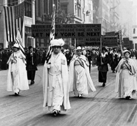 black and white image of women in the New York suffrage parade of the early 1900s