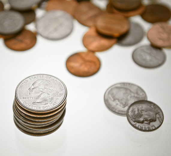 Loose coins are featured on a white background.