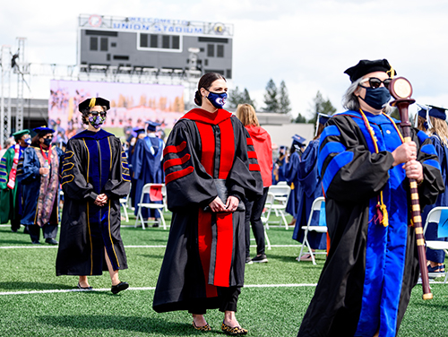Faculty and administrators enter the stadium for one of the undergraduate ceremonies. (GU photo by Matt Repplier)
