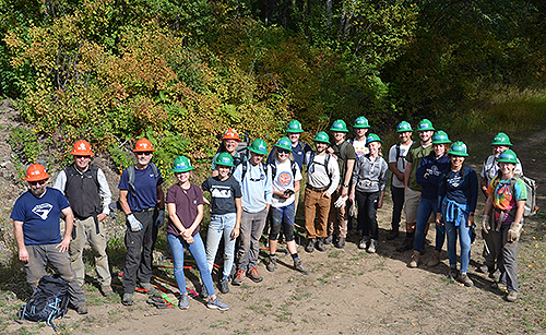 Gonzaga students in an environmental studies course conduct a service-learning project building a new trail with the Washington Trails Association on the recently acquired Mica Peak conservation land. (Photo courtesy Greg Gordon)