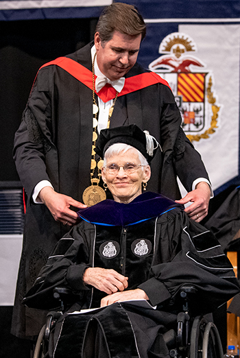 President Thayne McCulloh bestowed an honorary Doctor of Laws degree from Gonzaga University upon Judith Mayotte. (GU photo)