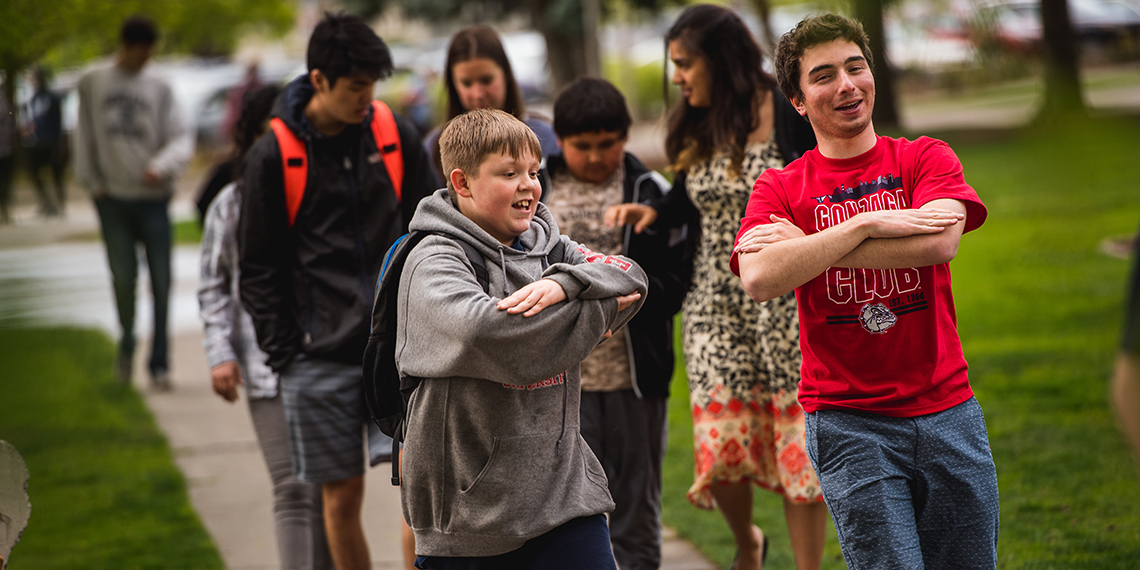 Ben Ranghiasci ('20) walking with his mentee during Campus Kids. (GU photo)