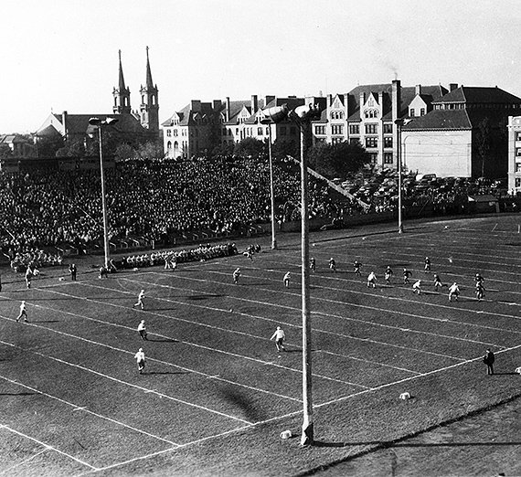 This 1930 photo depicts the view of the Gonzaga football stadium looking Northwest. Fans fill the stadium. (GU Archives)