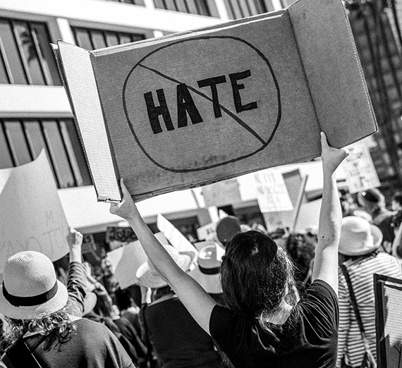 "A woman declares ""No Hate"" at a protest in Los Angeles, California 2017. (Photo courtesy T. Chick McClure)"