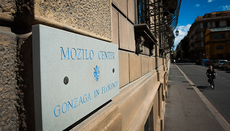 The Gonzaga in Florence sign is displayed on the side of a building.