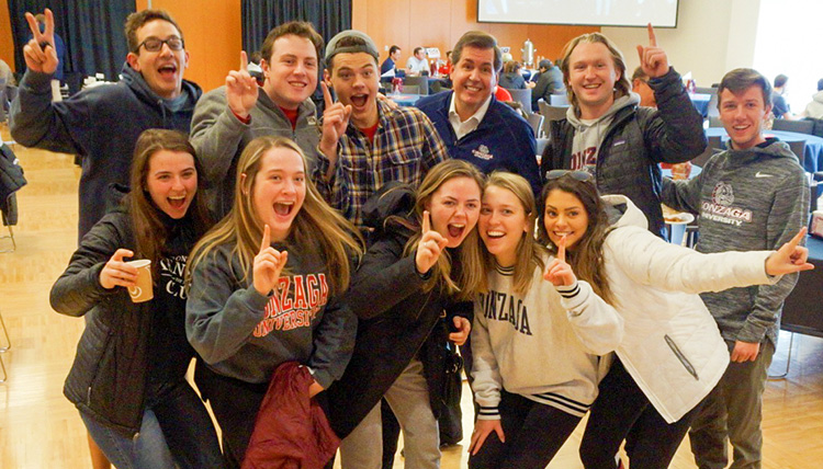 Gonzaga President Thayne M. McCulloh poses for a picture with students.