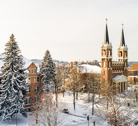 Sunshine and snow is shown on Gonzaga's campus and near St. Al's church.