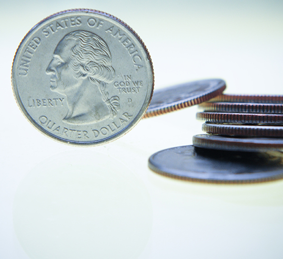 A stack of quarters is shown on a white background.