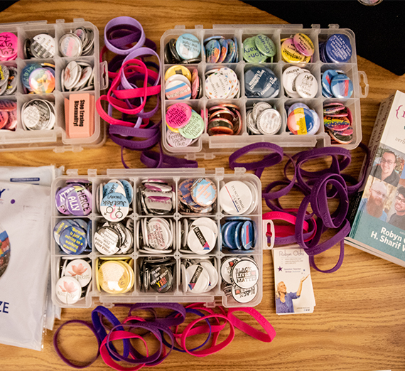 Plastic containers hold buttons, pins and wristbands that celebrate different gender identities.