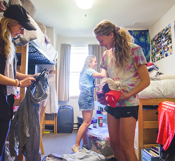 New roommates work to unpack their items during move-in weekend.