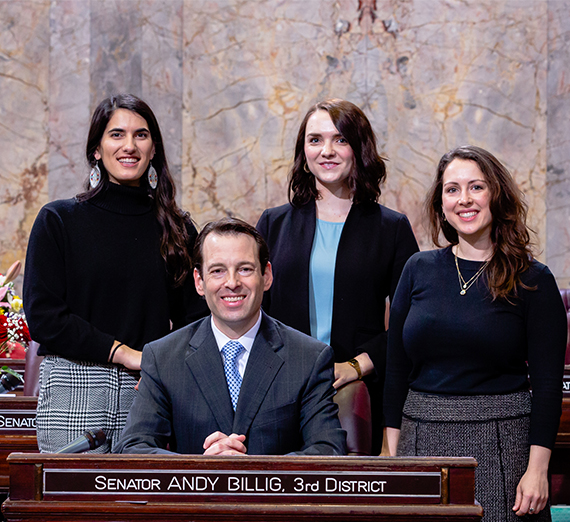 three female interns with Sen. Andy Billig