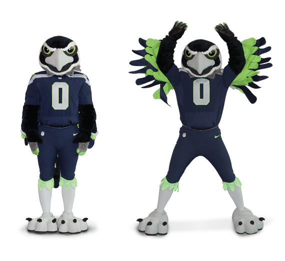 Blitz, the Seahawks mascot, demonstrates how to perform jumping jacks