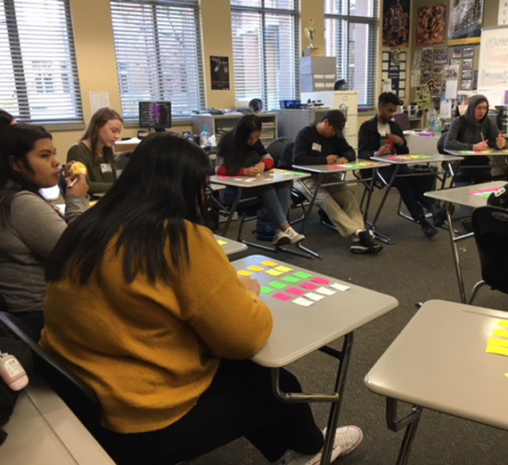 In pre-COVID-19 days, Rogers students meet with GU mentors at a SPARKS program in the high school.