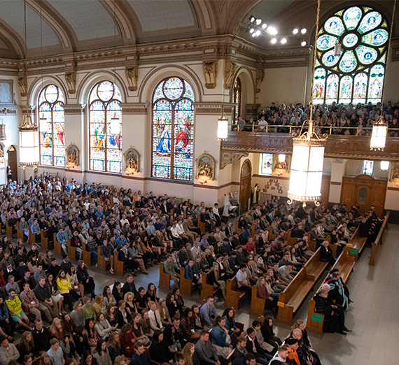 inside St. Aloysius Church, full with people