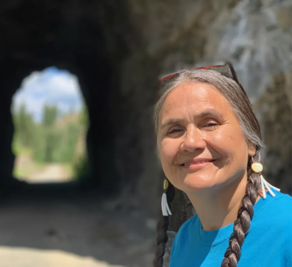 Native American woman near train tunnel