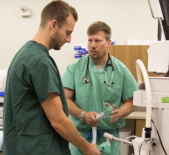 Dr. Geoff Jones, M.D., right, gives guidance