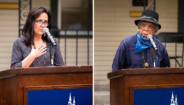 two native americans speak from podium