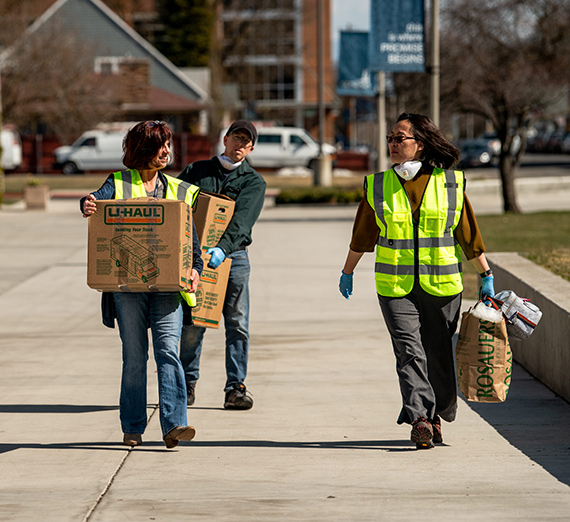 Staff help students move out of their dorms