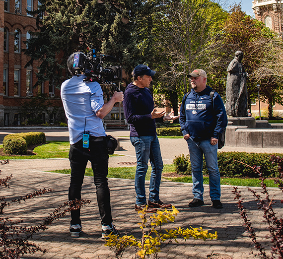 Video crew films Mike Rowe with Rick Clark