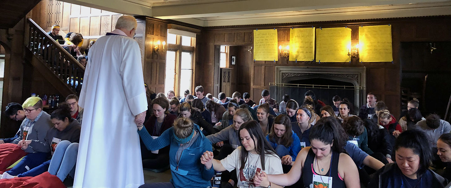 students praying together on retreat