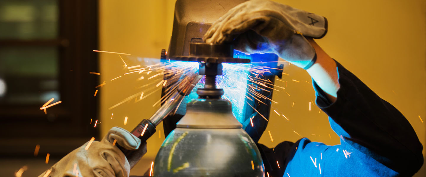 Mechanical engineering student welding