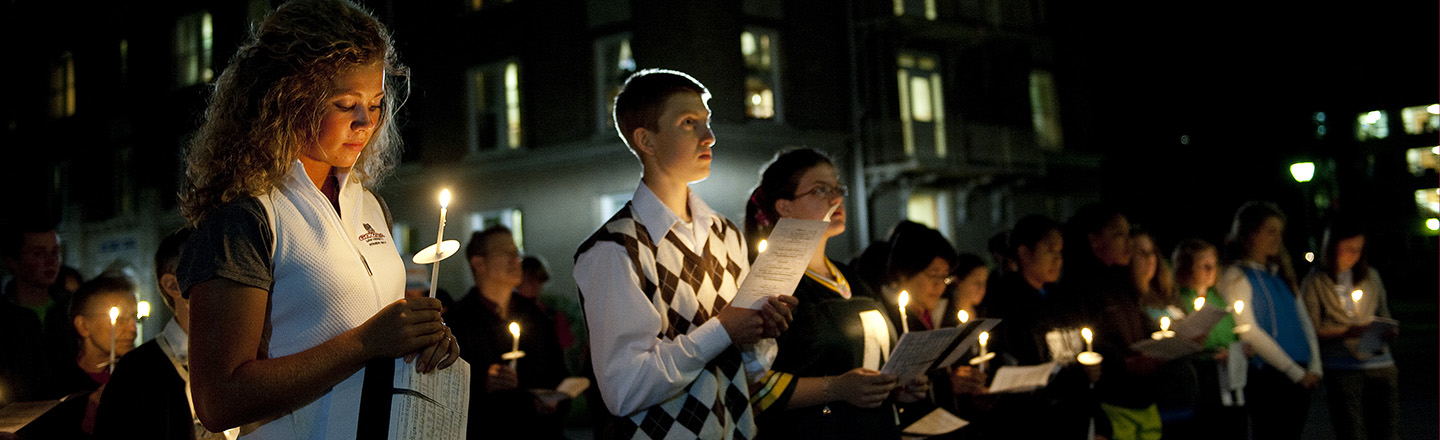 tudents at candlelight vigil
